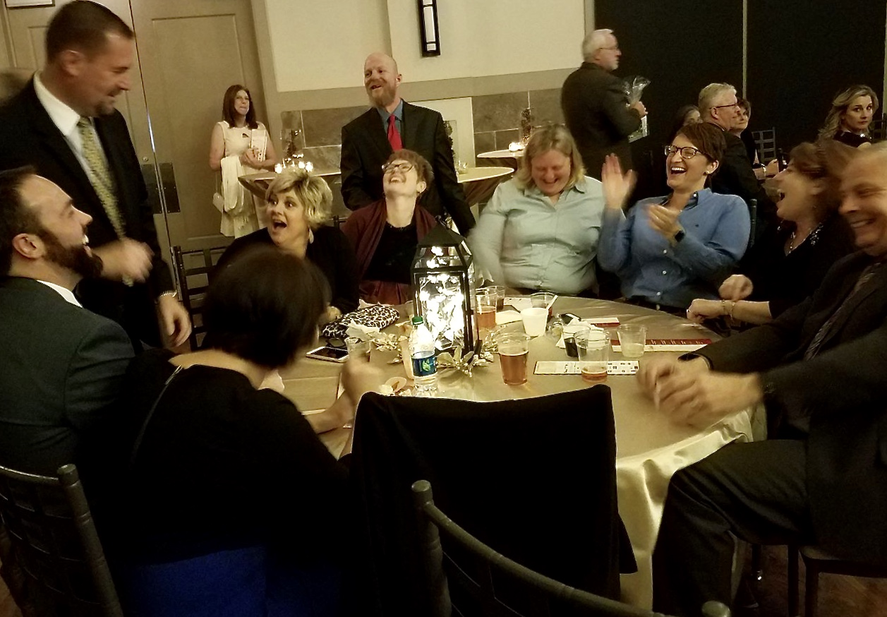 Curtis entertains groups tableside during a charity event.