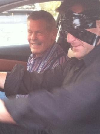 Bobby Unser smiles in relief as Curtis The Mentalist returns him safely after a blindfolded car drive.