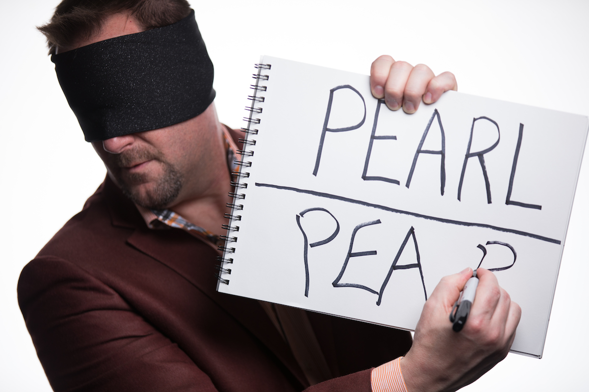 Curtis The Mentalist writes a spectator's word while blindfolded.