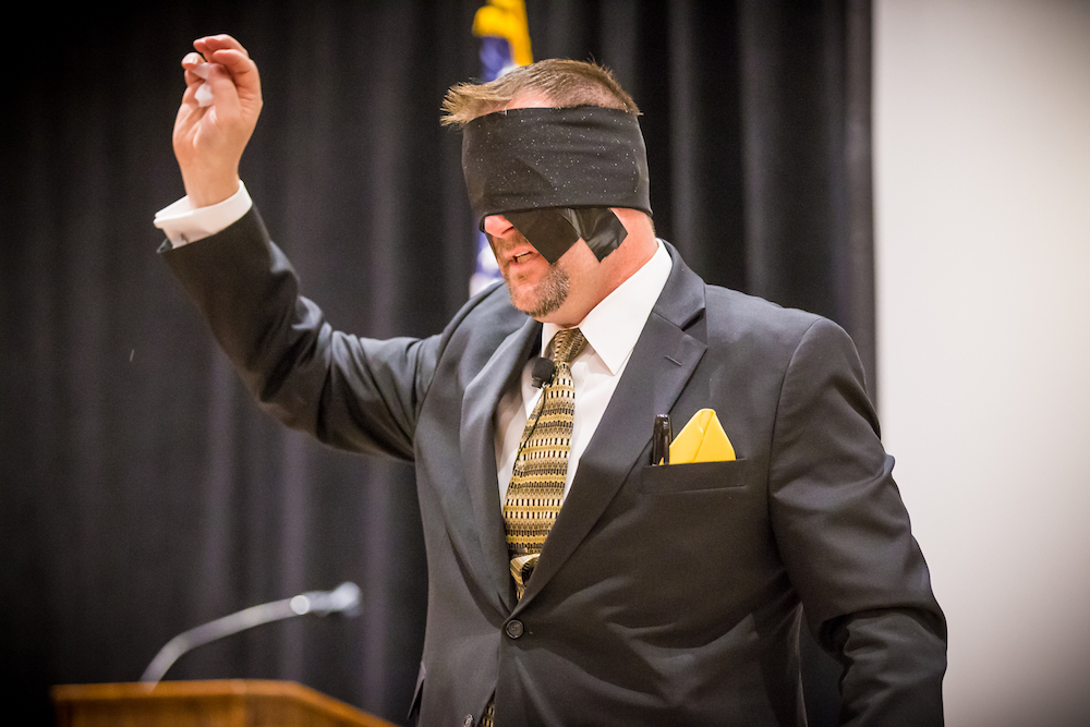 Curtis The Mentalist performs his blindfolded act for a corporate banquet.