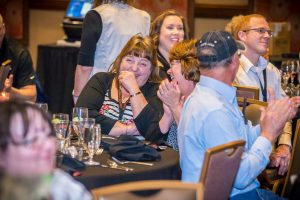Audience members laugh during a comedy mind reading show by Curtis The Mentalist at the Kansas Star Casino.