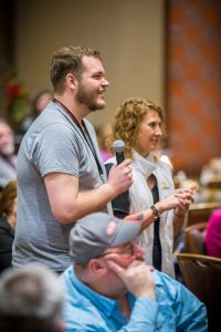 A participating spectator smiles during the comedy mind reading act by Curtis The Mentalist at the Kansas Star Casino